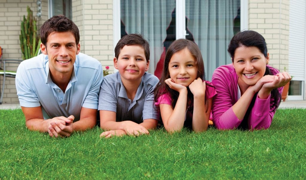 image of a family lying on the grass